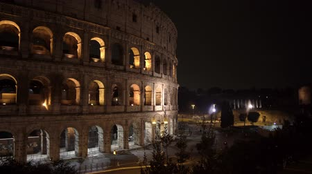gladiatorial : ROME - FEB 20: Roman Colosseum Coliseum Flavian Amphitheatre Anfiteatro Flavio Colosseo, an oval amphitheatre in the center of Rome, Italy. Night time. Left to right pan real time medium shot