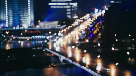 trancado : Cars riding across the river near the Arbat in Moscow, Russia. Summer night. Big city life concept. Locked down real time medium shot blurred