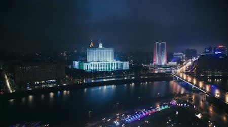 minister : MOSCOW - NOV 23: The House of the Government of the Russian Federation, the Arbat street at night, November 23, 2017 in Moscow, Russia. Cars moving at night. Left to right pan shot Stock Footage