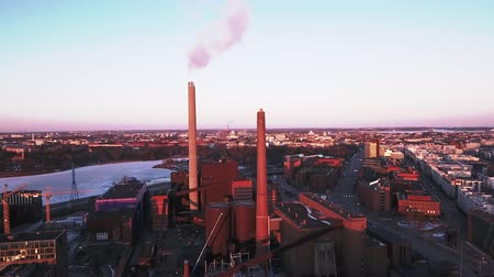 hall : The factory inside the city of Helsinki with tall pipes that blowing white smoke from it Stock mozgókép
