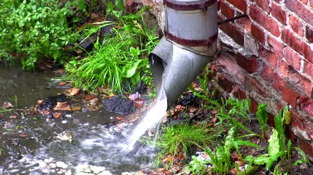 casas : downspout on the old wall in the rain