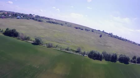 szybowiec : Flying over the Countryside, Birds-eye. Extreme camera  is mounted on the wing RC glider. Wideo