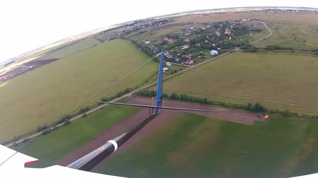 szybowiec : Flying over the Countryside, Birds-eye, look back. Extreme camera  is mounted on the wing RC glider.