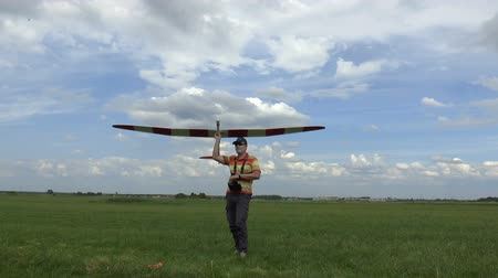 airplane engine : Man Launches RC Glider in the Sky, on blue sky background Stock Footage
