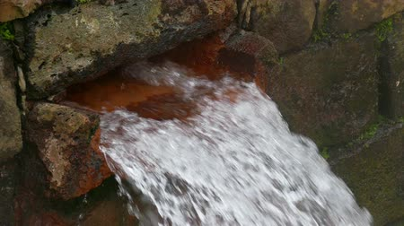 furnas : Hot Spring Water Flow from Pipe on Wall, closeup Stock Footage