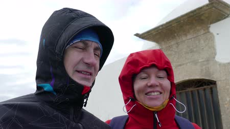 сильный : Adult Couple Resist Hurricane Winds, closeup
