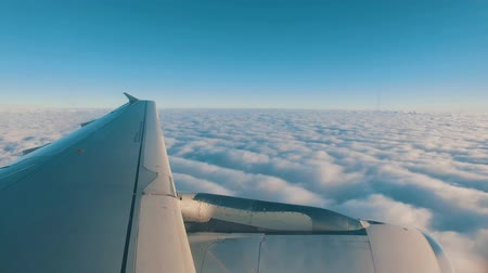 Airplane is Flying Above the Clouds, view from the porthole