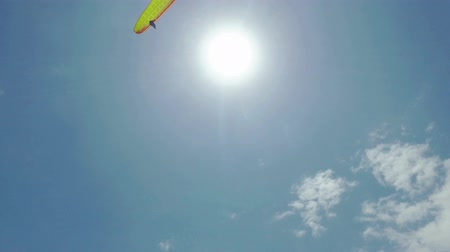 akció : Paragliders Fly Over the Ocean Beach, sunny day