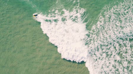 surf : Aerial View of Surfers Riding Green Ocean Waves, Portugal