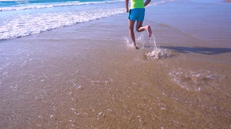 Close Up of Feet Running at the Beach, slow motion