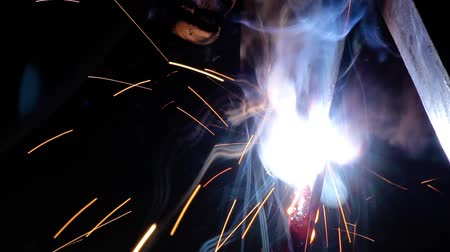 angle grinder : Welder working in industry with welding machine small sparks particle Stock Footage