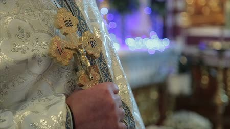 christening : gold crucifix in priest hands Stock Footage