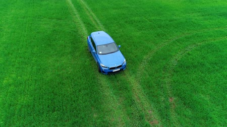 fabricante : blue BMW x2 2018 badge shield, logo on Green field aerial shot view 08.10.2108 Lviv Ukraine