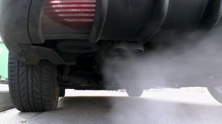 escape : HD footage of car exhaust fumes on a cold day