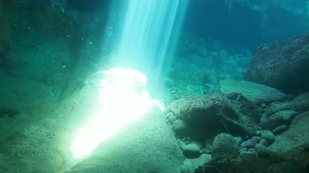 underwater video : Underwater footage of sunrays inside an underwater cave