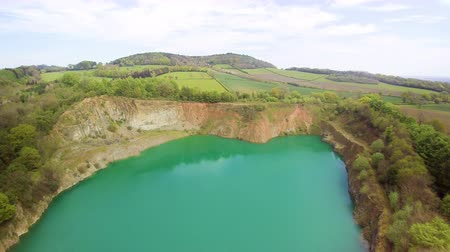 delikleri : Aerial footage of a blue heart shaped quarry