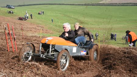 motorcar : WORCESTER,UK - MARCH 13 2016 : Competitors take part in a hill climb to see who can drive their car furthest up a muddy hillside. This was a free to enter event with no photography restrictions. Stock Footage