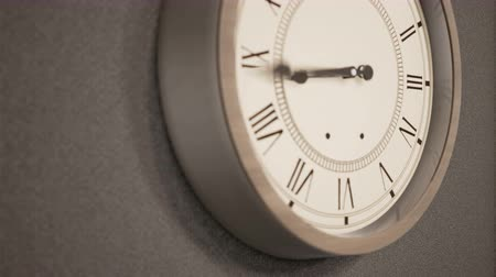 ticking : Timelapse of Vintage clock on dark wall. Two camera views, 60fps animation
