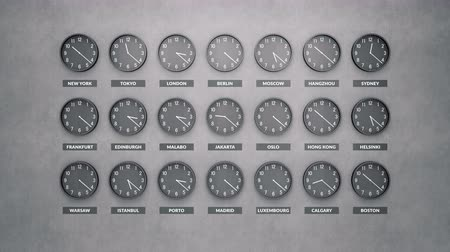 greenwich : Round clocks show different time zones on a dark concrete wall. Loopable clock face timelapse 60 fps animation