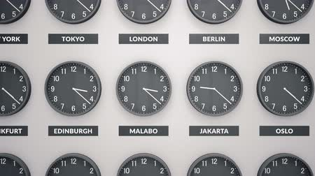 greenwich : Round Clocks Show. Different Time Zones On White Wall. Camera Moves Left To Right. Clock Face Timelapse 60fps Animation Stock Footage