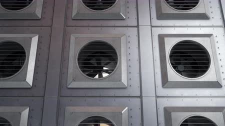 hutnictwo : Wall with industrial ventilation fans units during rotation. Indoor or outdoor cooling or heating process. 60 fps seamless animation.
