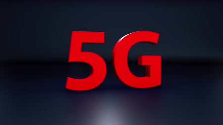 Red 3d 5G word isolated on dark blue background, concept of new technology delivering. Camera rotate near giant letters, 3d cgi 60 fps animation. Stockvideo