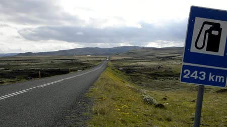 labeled : Road sign on Iceland, next station 243 km