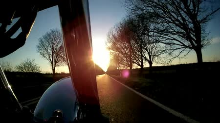 motocykl : Motorcycle on the road with sunset Wideo