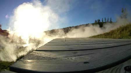 Fumes from geyser with bridge Vídeos