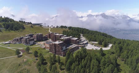 valais : Thyon frontal traveling in clouds - Aerial 4K Stock Footage