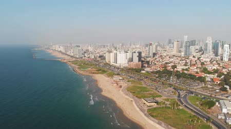 Aerial view of flight above Tel Aviv, Israel with city skyline. Epic shot over sea shore. Amazing aerial shot. flight of drone over public beach in tel Aviv district of Jaffa. top view, aerial view