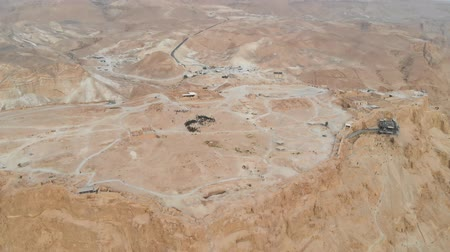 israelite : flying around Masada fortress area Southern District of Israel Dead Sea area Southern District of Israel. Ancient Jewish fortress of the Roman Empire on top of a rock in the Judean desert. view air.
