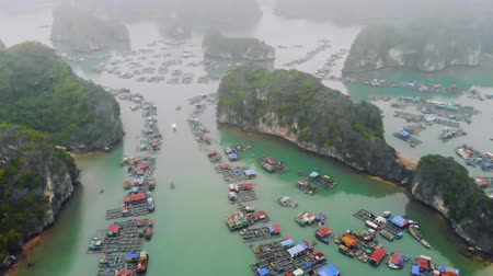 ninh : Aerial view of floating villages around Cat Ba islands. Cat Ba is the largest of the 366 islands, which make up the southeastern edge of Ha Long Bay in Vietnam.
