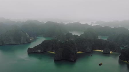 grim : Ha long bay from the top. High rocks in the water. Halong Vietnam Stock Footage
