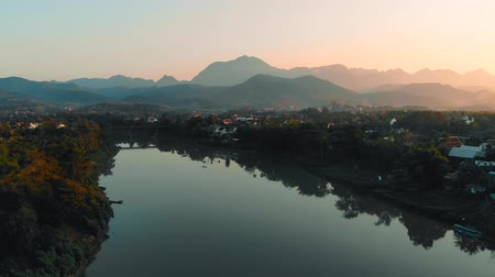 luang : Beautiful sunset over in Luang prabang, Laos. Nam Kahn River, a tributary of the Mekong River,