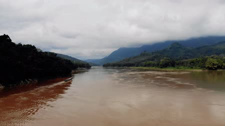 luang : Mekong River in the background of the mountains, laos. brown water in river.