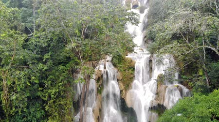 luang : The Kuang Si Falls or known as Tat Kuang Si Waterfalls. These waterfalls are favorite side trip for tourists in Luang Prabang with a turquoise blue pool