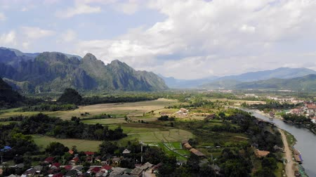 vientiane : Aerial view of farm fields and rock formations in Vang Vieng, Laos. Vang Vieng is a popular destination for adventure tourism in limestone karst landscape.
