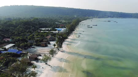 cambojano : Birds eye drone aerial view of single pier in crystal clear blue sea on secluded beach on Cambodian island Koh Rong on sunny summer day