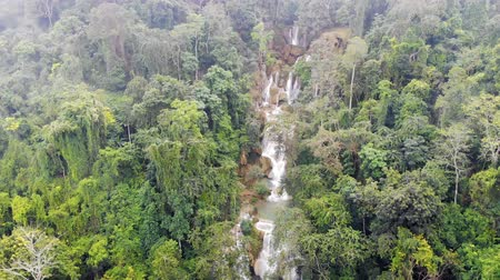 luang : Long Exposure photography of Tad Kuang Si waterfall, Lungprabang, Lao. Beautiful photo of exotic Asian landscape. video from the drone, Stock Footage