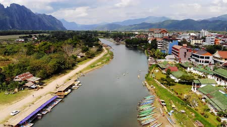 vientiane : Nam Song River in Vang Vieng, Vientiane Province, Laos. Vang Vieng is a popular destination for adventure tourism in limestone karst landscape