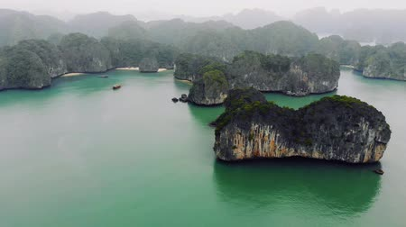 halong : Stunning Halong Bay in Vietnam. Halong cruise in foggy weather through world famous Bay. Amazing views cruise ship