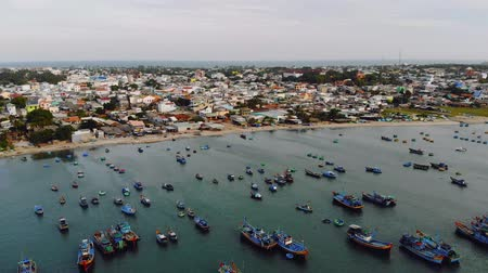 fly fishing : Fishing village in Mui Ne, Vietnam. A lot of old fishing boats in the poor fishing village of Vietnam. drone movie Stock Footage
