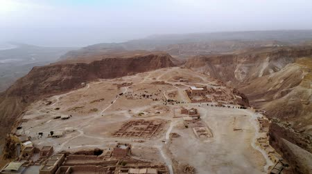 israelite : flying over Masada fortress area Southern District of Israel Dead Sea area Southern District of Israel. Ancient Jewish fortress of Roman Empire on top of a rock in Judean desert. view from the air. 4k Stock Footage