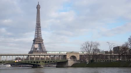 bir hakeim : Metro crossing Passy bridge with Eiffel Tower in background - Paris, France