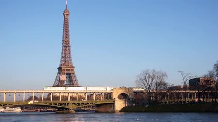 bir hakeim bridge : Sunset over Metro crossing Eiffel tower with Eiffel Tower - Paris, France