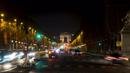 arch of triumph : Timelapse - Night Traffic on Champs-Elysees with Arc de Triomphe in background, from place de la Concorde - Paris, France Stock Footage