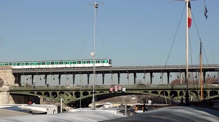 french metro : Metro traffic on Pont Bir-Hakeim (Passy viaduc) with barges in foreground - Paris, France Stock Footage
