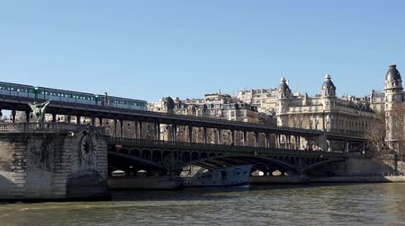 french metro : Metro traffic on Pont Bir-Hakeim (Passy viaduc) with view over Passy station buildings - Paris, France Stock Footage