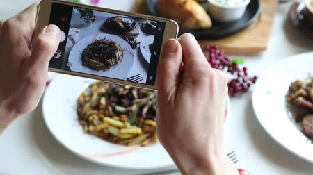 Hands taking photo various dishes with smartphone Stock Footage